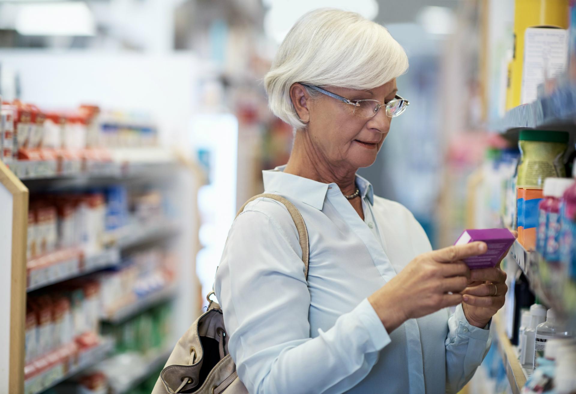 woman choosing OTC product